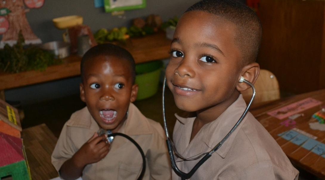 Young boys play doctor during a Medical Outreach ran by Dentistry interns during a Dentistry placement in Jamaica.